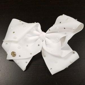Jo-Jo Swisa large white bow rhinestoned
